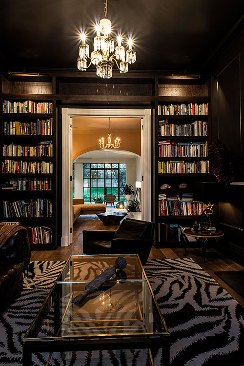 Dark and moody library created with winter evenings by the fire in mind.